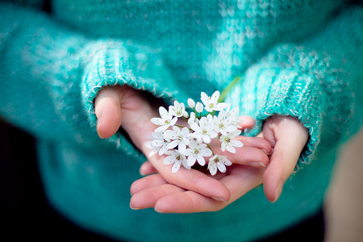 White flowers in womans hands